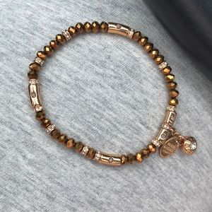 Beautiful copper henri bendel stretch bracelet.